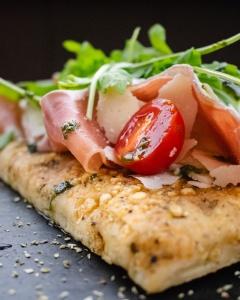 Food Photography Portfolio at ildiva.com - Focaccia with Parma ham, Rucola, Cherry Tomatoes and Parmigiano Reggiano